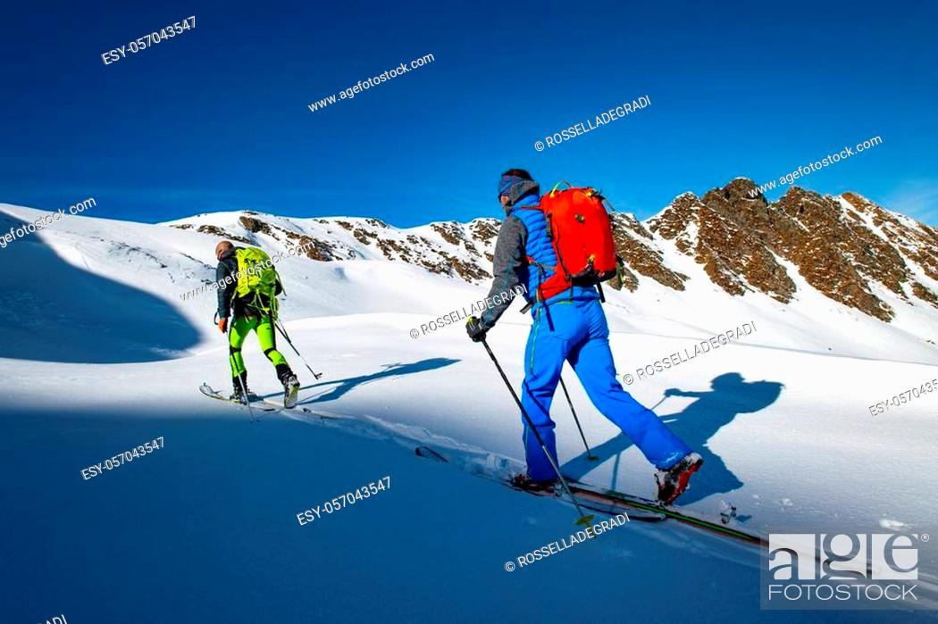 Stock Photo: Two alpinist skiers during a ski mountaineering trip.