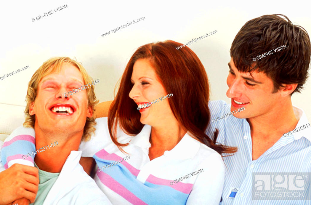Stock Photo: Young group of people laughing.