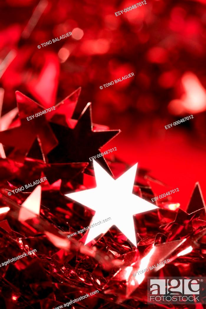 Photo de stock: Christmas star card decoration still at studio red background.