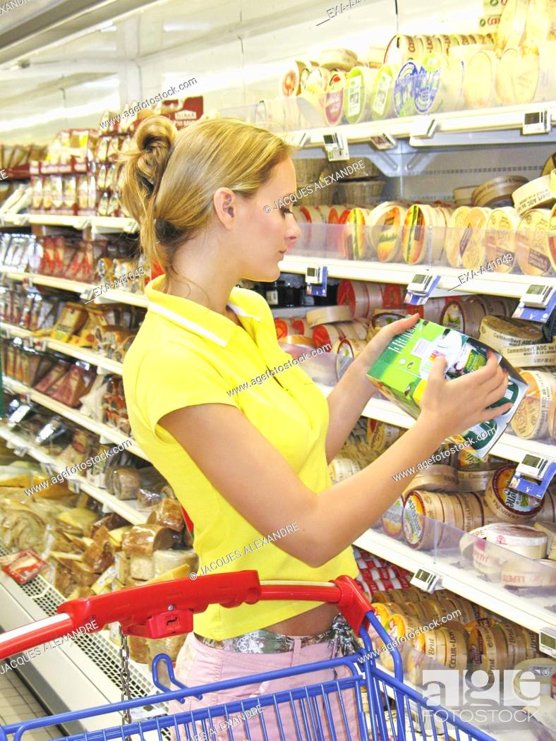 Stock Photo: Young woman shopping in supermarket.