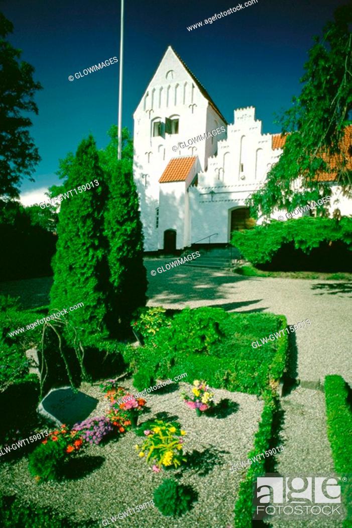 Stock Photo: Cemetery in front of a church, Funen County, Denmark.
