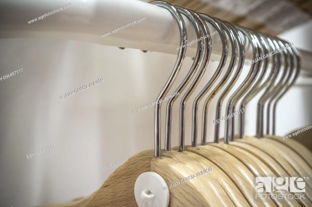 Stock Photo: Empty wooden hangers. Selective focus.