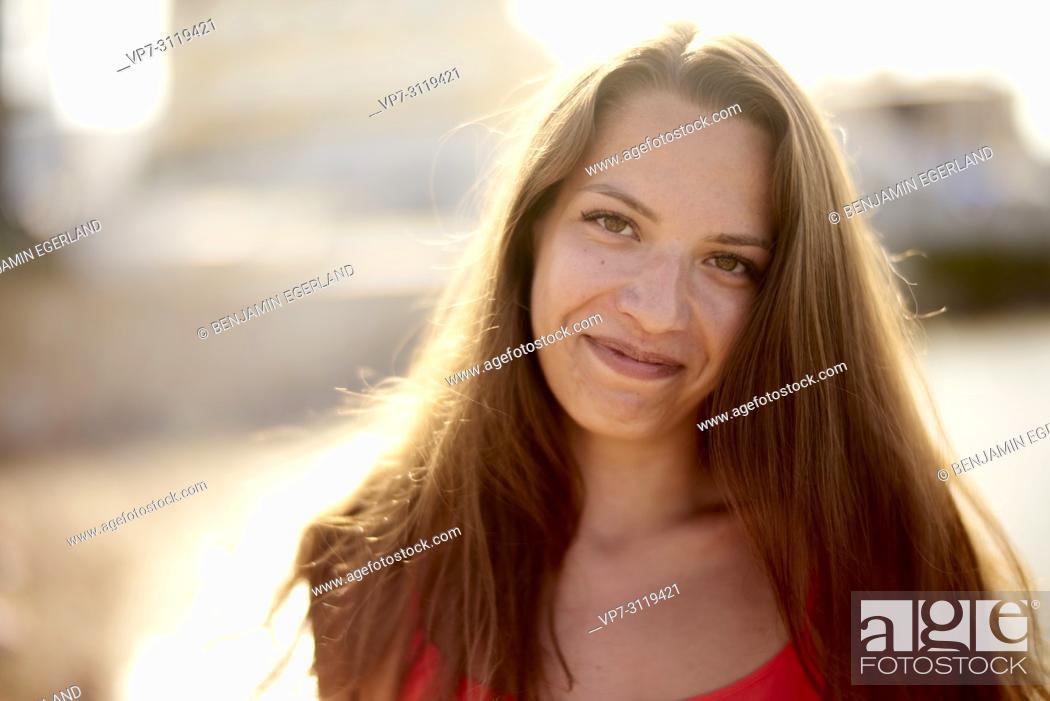 Stock Photo: portrait of woman at beach in beautiful sunlight in holiday destination Chersonissos, Crete, Greece.
