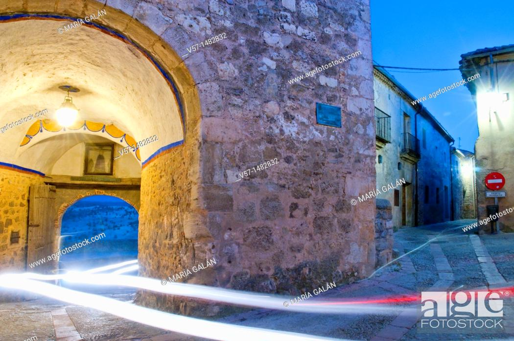 Stock Photo: Arch and street, night view. Pedraza, Segovia province, Castilla León, Spain.