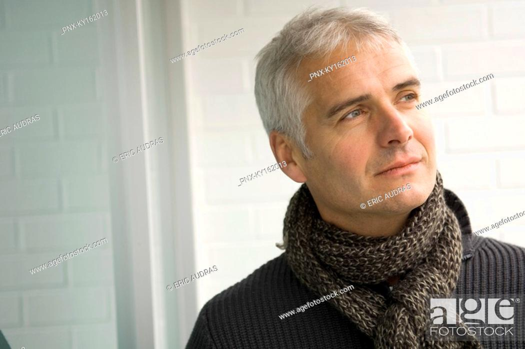 Stock Photo: Close-up of a mature man thinking.
