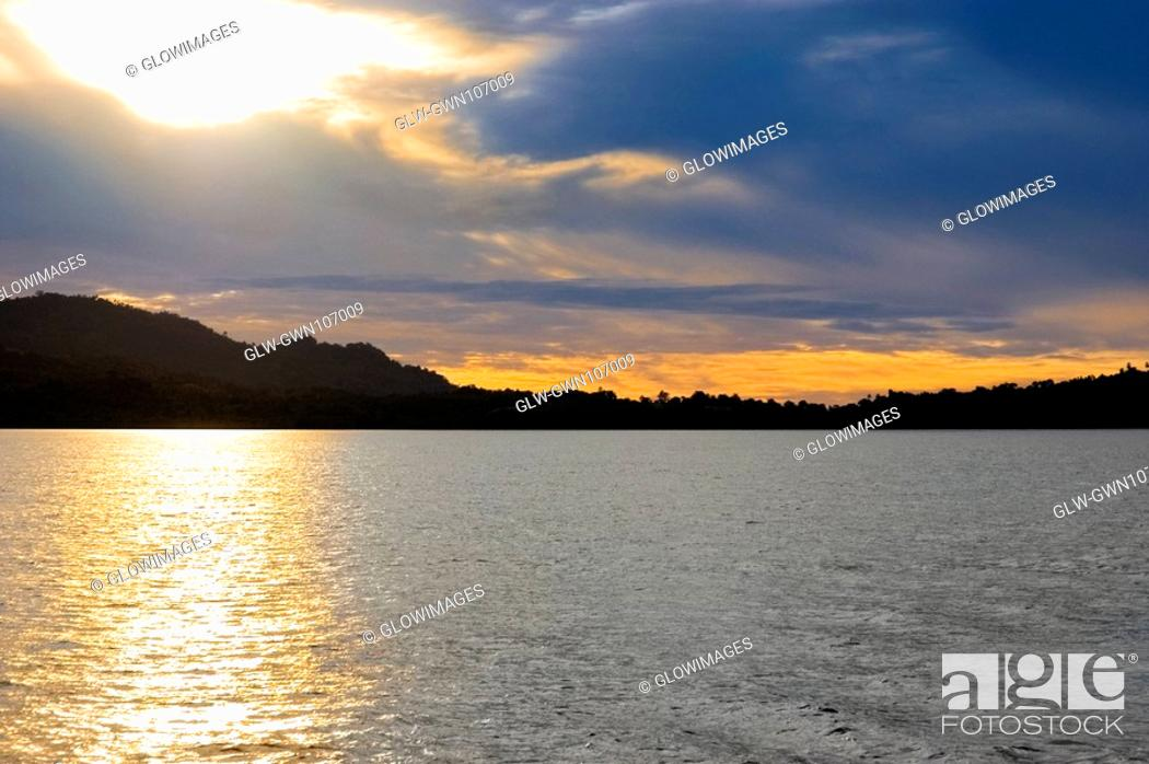 Stock Photo: Sunset over the sea, Lembeh Strait, Sulawesi, Indonesia.