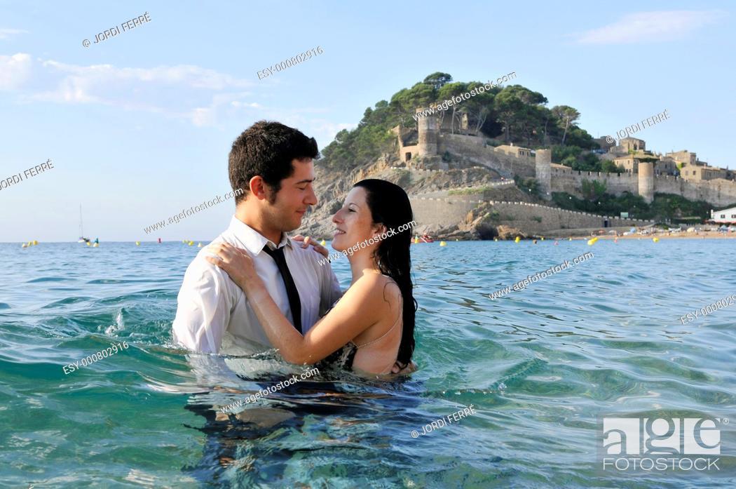 Imagen: Young couple on the beach, Tossa de Mar, Costa Brava, Girona, Spain, Europe.
