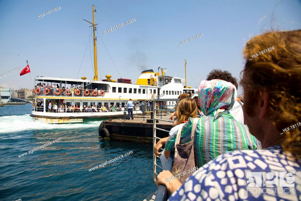 Stock Photo: Tourists waiting for the ship.