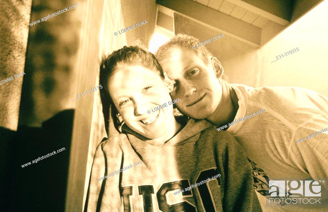 Stock Photo: Teen boy and girl.