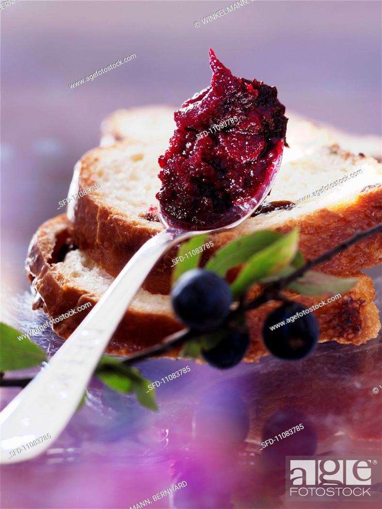 A Spoonful Of Sloe Jam And Two Slices Raisin Bread Stock Photo