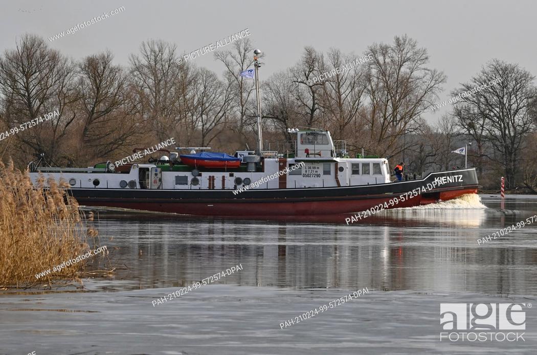"Stock Photo: 24 February 2021, Brandenburg, Kienitz: The icebreaker """"Kienitz"""" is underway upstream on the German-Polish border river Oder in the Oderbruch."
