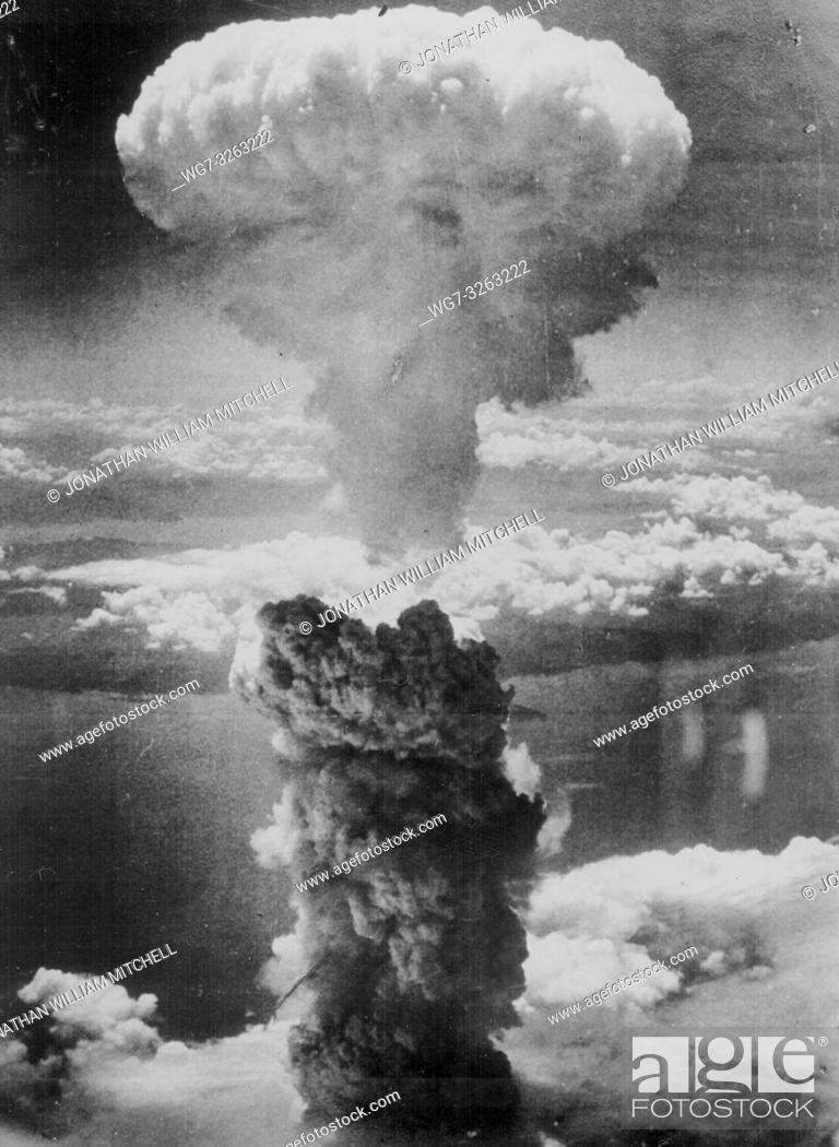 Stock Photo: JAPAN Nagasaki -- 08 Aug 1945 -- Out with a bang. . . A dense column of smoke rises more than 60, 000 feet into the air over the Japanese port of Nagasaki.