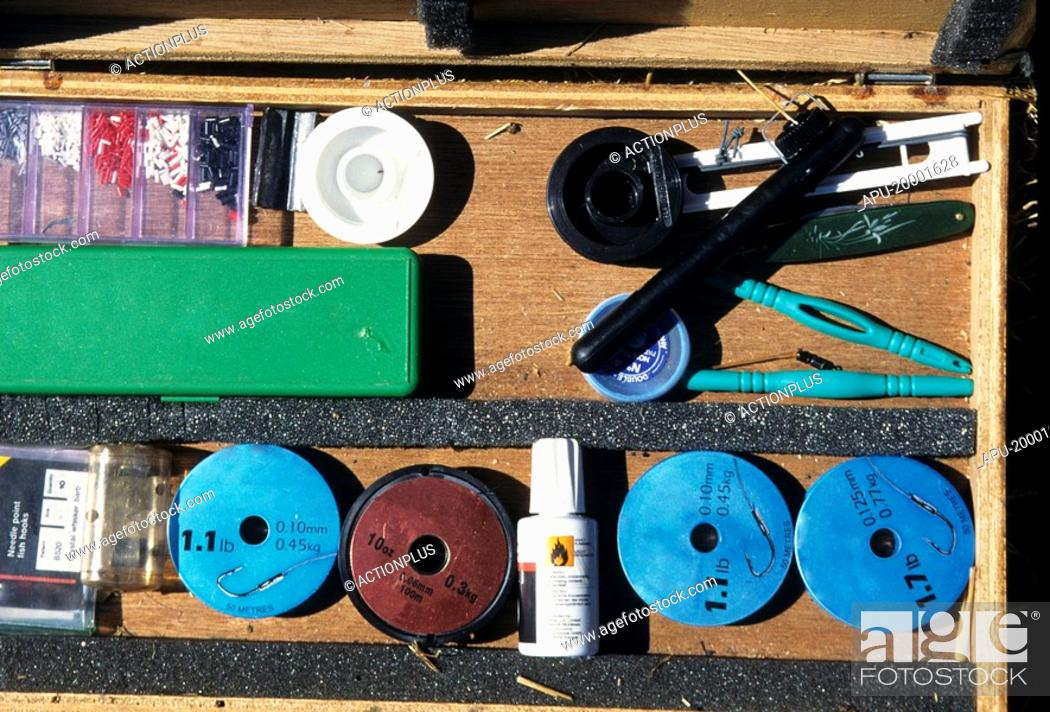 Stock Photo: Angling equipment in an open tackle box.