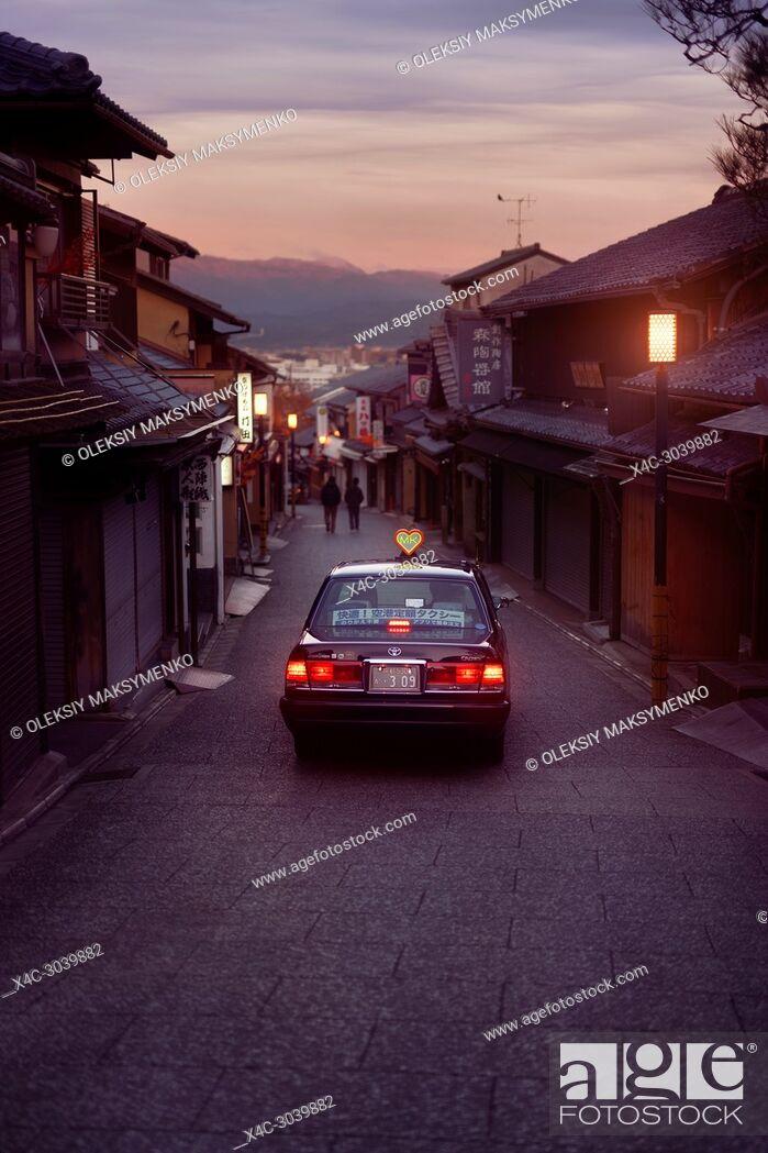 Stock Photo: Early morning taxi cab on Matsubara dori empty street in Kyoto before sunrise in autumn near Kiyomizu-dera temple. Higashiyama, Kyoto, Japan travel.