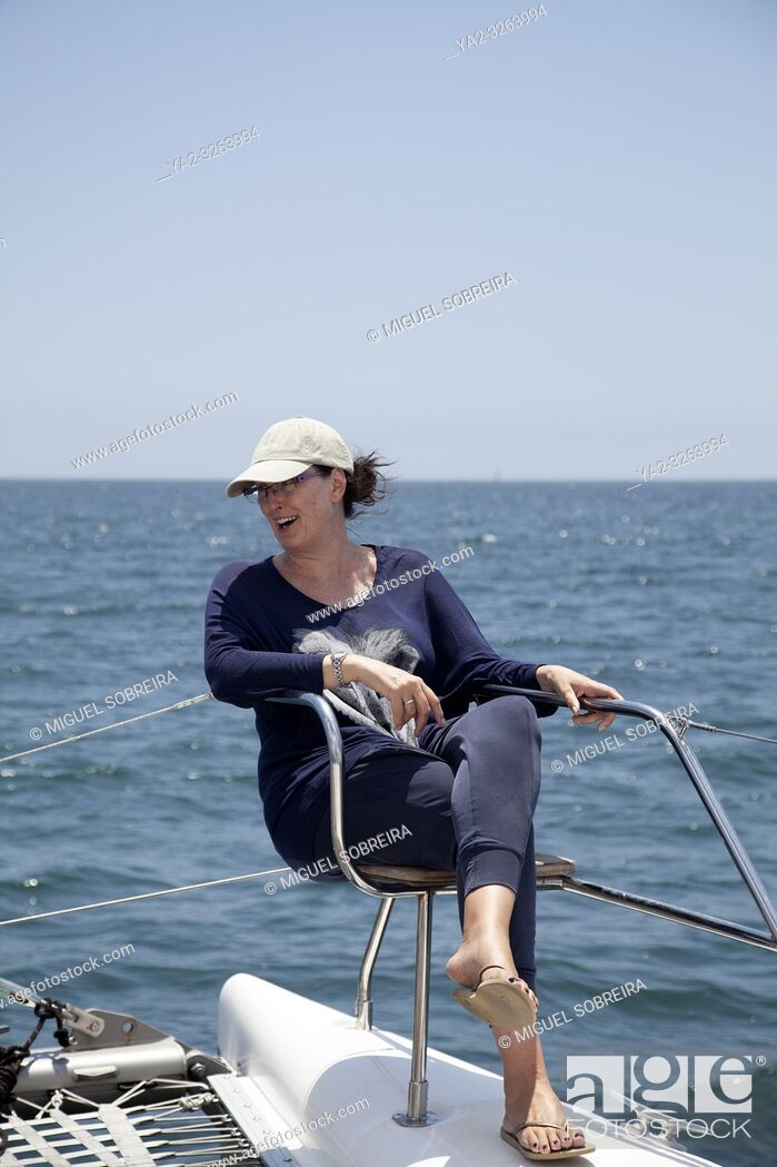 Stock Photo: Woman On Deck Seat on Catamaran at Sea in Table Bay, Cape Town, South Africa.