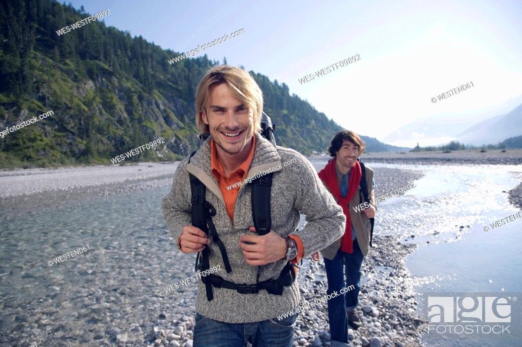 Stock Photo: Germany, Bavaria, Tölzer Land, Friends hiking.