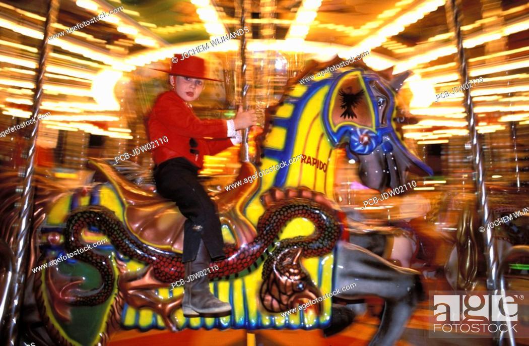Stock Photo: Jerez de la Frontera, a girl in tio pepe costume in a merry go round at Feria del caballo.