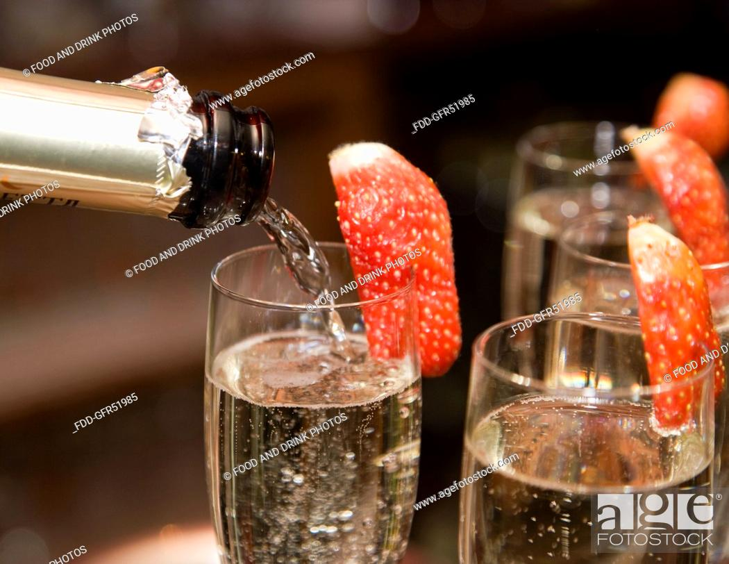 Stock Photo: Pouring champagne.
