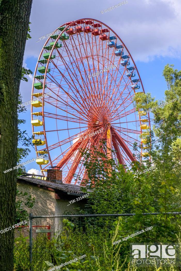 Stock Photo: Berlin, Germany. The Big Wheel inside amusement park 'Spreepark' or 'Park am Spree' hasn't turned since the Berlin Wall was torn down.