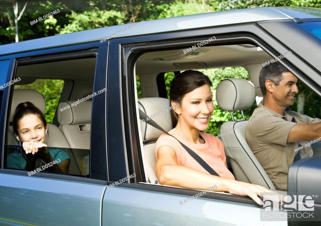 Stock Photo: Hispanic family driving in car.