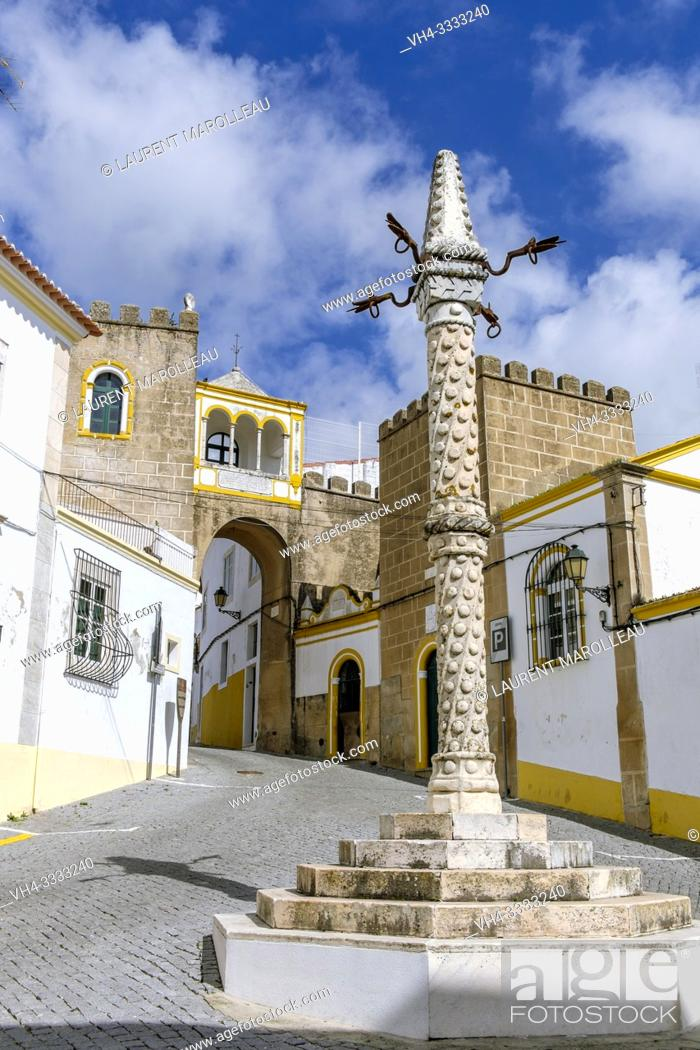 Stock Photo: Marble Pillory and Arab Archway of Largo Santa Clara, Garrison Border Town of Elvas and its Fortifications, Portalegre District, Alentejo Region, Portugal.