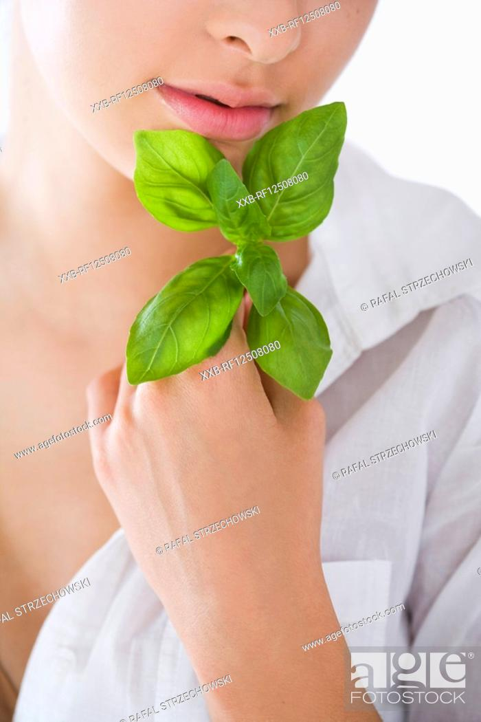 Stock Photo: young woman with fresh basil.