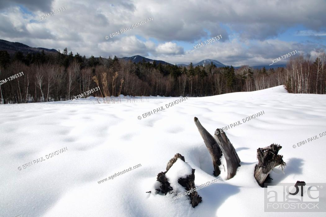 Stock Photo: Mountain range from a sandpit along the Kancamagus Highway during the winter months in the White Mountains, New Hampshire USA  This area was part of the Swift.