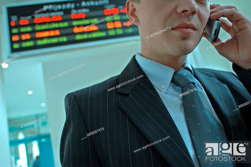 Stock Photo: Cell Phone, Color Image, Man, People, Adult, Suit, Black, Object, Coloured, Colorful, Character, Place, Mobile, Clothing, Full, Garment, Colors, Male