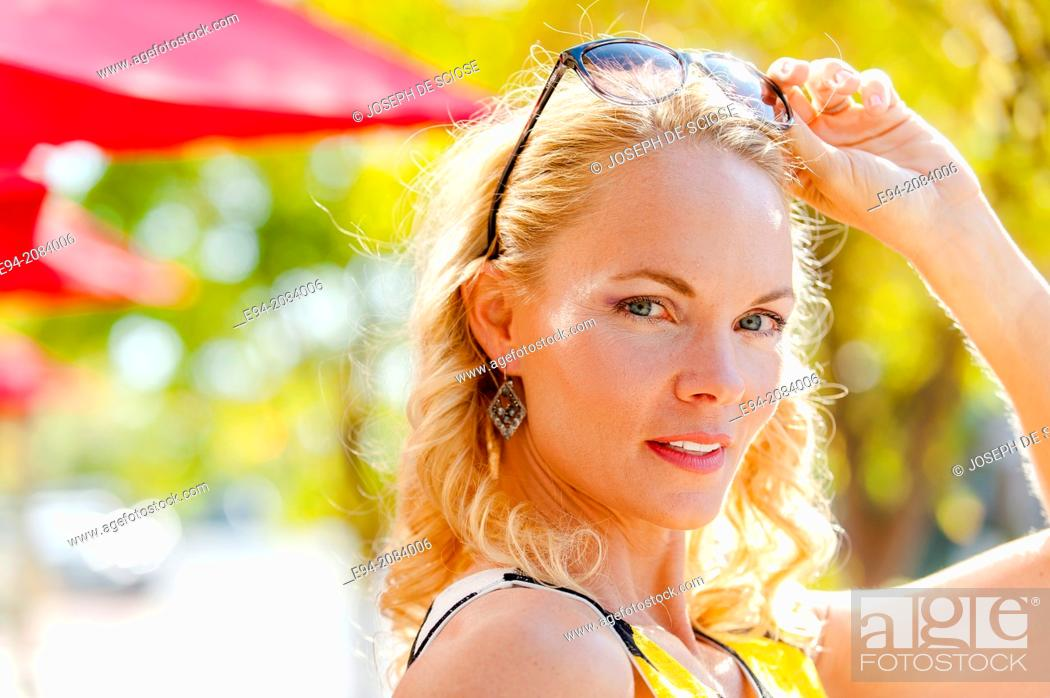 Photo de stock: A 39 year old blond woman with a serious expression.