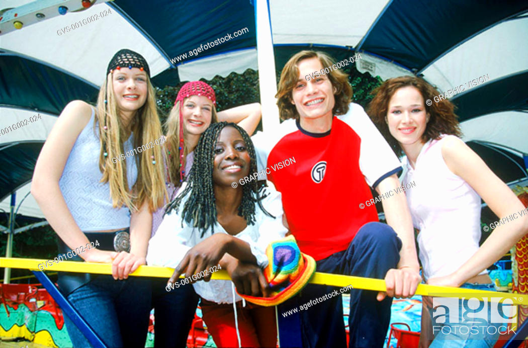 Stock Photo: Group of Teenagers in Amusement Park.