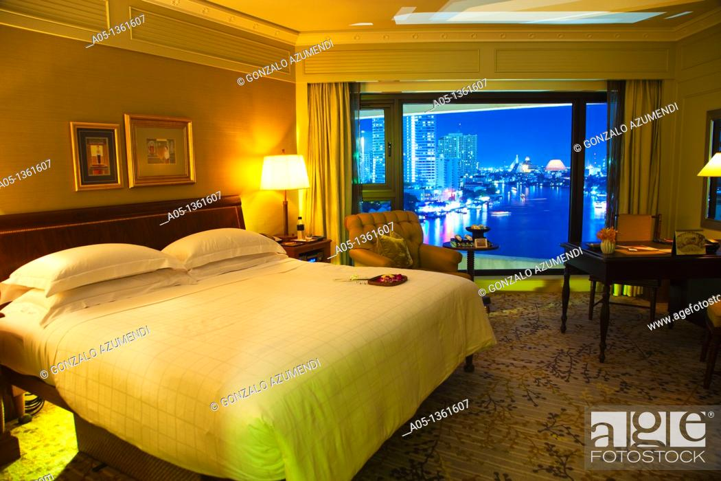 Stock Photo: Bedroom with the evening over the Mae Nam Chao Phraya river view  Mandarin Oriental Hotel, Silom District, Bangkok, Thailand, Southeast Asia, Asia.
