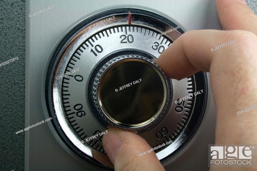 Photo de stock: Hand Turning Dial on Combination Lock.