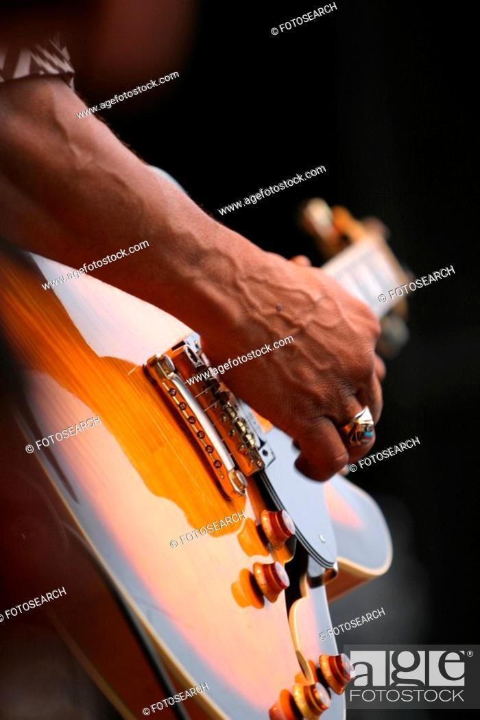 Stock Photo: guitar, guitarist, close-up, fingers, strumming, playing.
