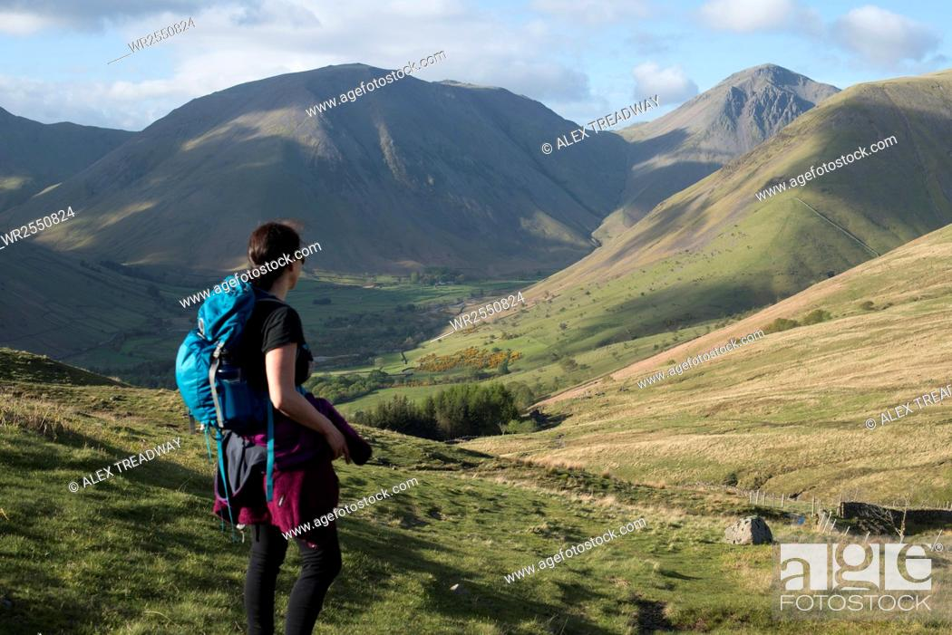 Stock Photo: Trekking in the English Lake District in Wast Water with views of Kirk Fell and Great Gable in the distance, Lake District National Park, Cumbria, England.