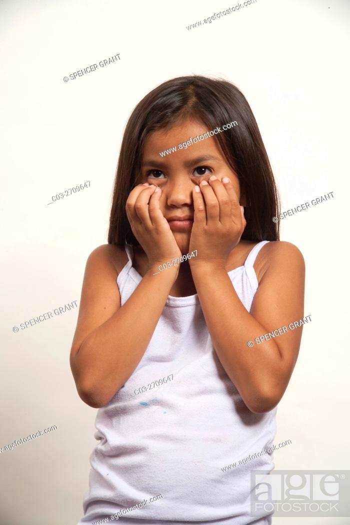 Stock Photo: A demonstrative Native American girl member of the Acjachemen tribe covers her face in shyness. . MODEL RELEASE.