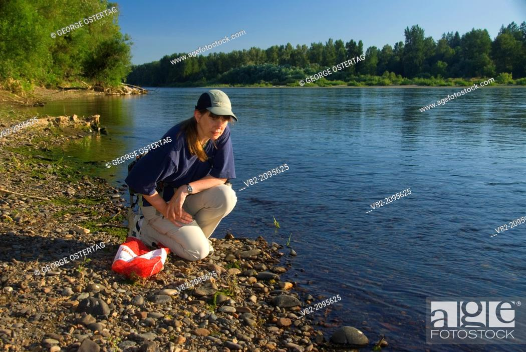 Stock Photo: Rock-collecting on Willamette River bar, Willamette Mission State Park, Oregon.