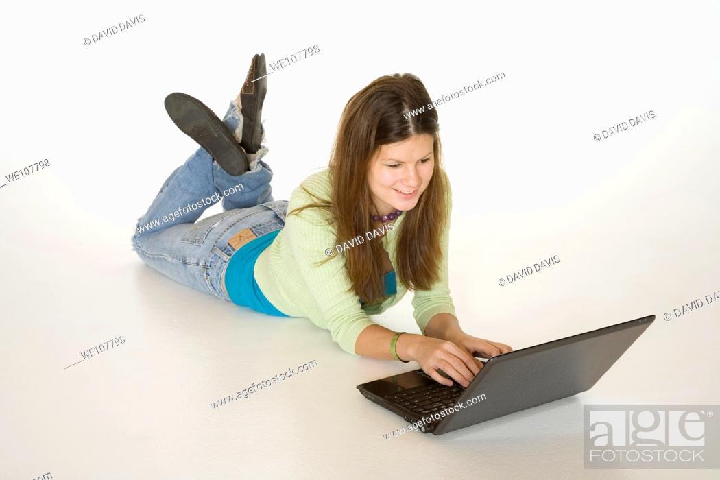 Stock Photo: Teenage girl working on laptop computer.