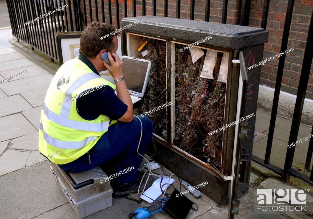 Miraculous British Telecom Engineer Working On A Telephone Wiring Junction Box Wiring Digital Resources Funiwoestevosnl