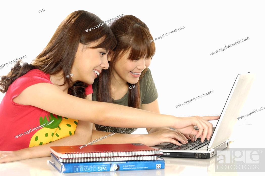 Stock Photo: Two female university students using a laptop.