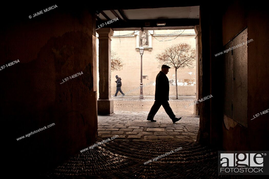 Stock Photo: View down a laneway in Alcalá de Henares near the house of Miguel Cervantes, Madrid Spain.