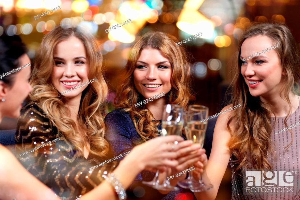 Stock Photo: celebration, friends, bachelorette party and holidays concept - happy women with champagne glasses at night club.