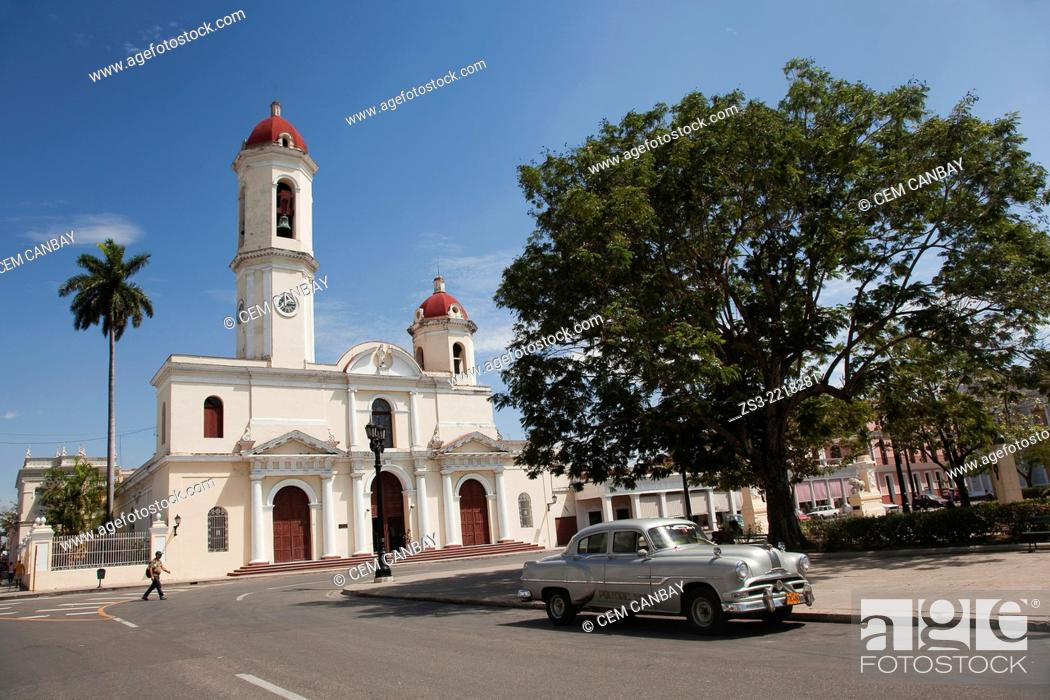 Stock Photo: Purisima Concepcion Cathedral in Jose Marti Park with an old American car in the foreground, Cienfuegos, Cuba, West Indies, Central America.