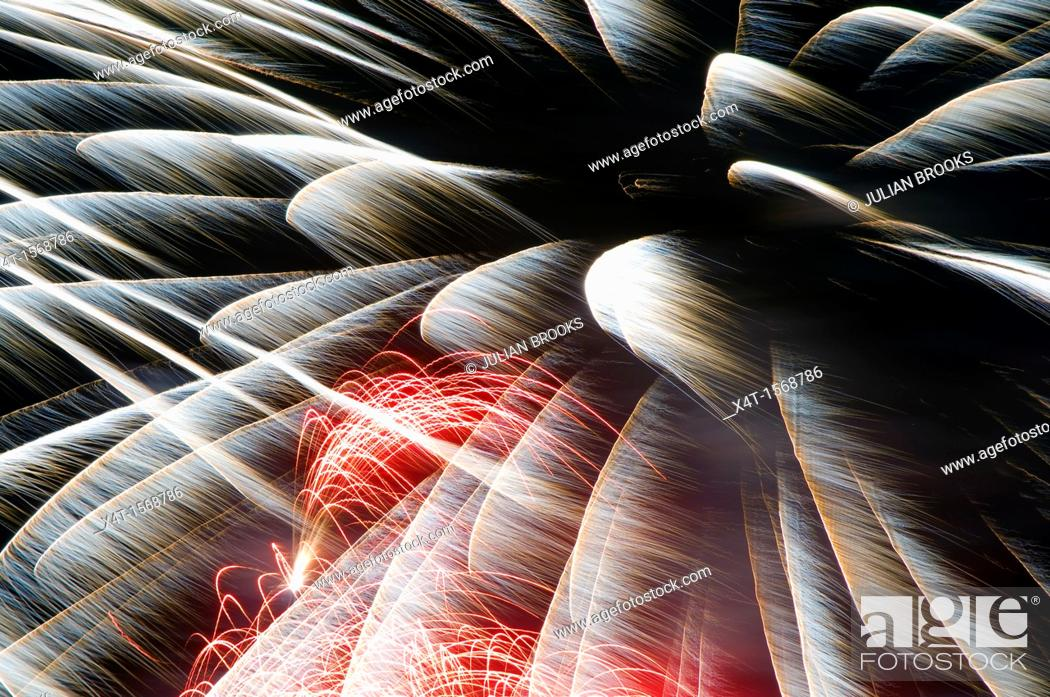 Stock Photo: Long exposure of fireworks in the night sky.