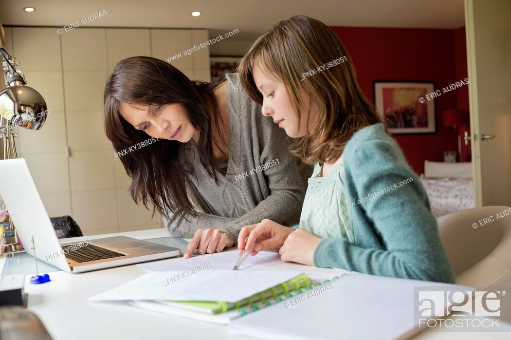 Stock Photo: Girl studying with her mother at home.