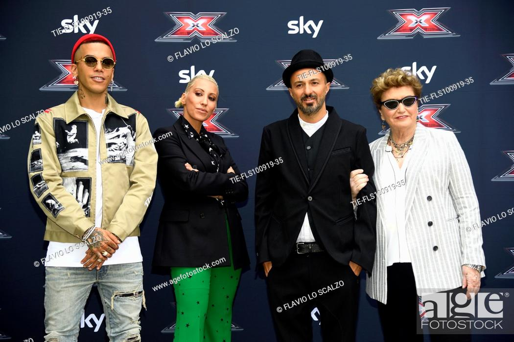 Stock Photo: Rapper Sfera Ebbasta, singer Malika Ayane, singer Samuel, record producer Mara Maionchi during the photocall of X Factor 2019, Milan, ITALY-10-09-2019.