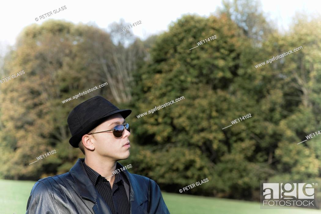 Stock Photo: Young man in a park.