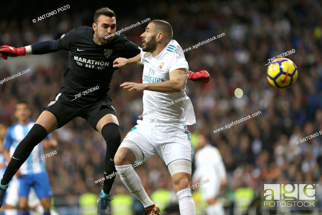 Stock Photo: MADRID, SPAIN. November 25, 2017 - Roberto Jimenez and Benzema looking for the ball. Real Madrid have chalked up an important victory, 3-2.