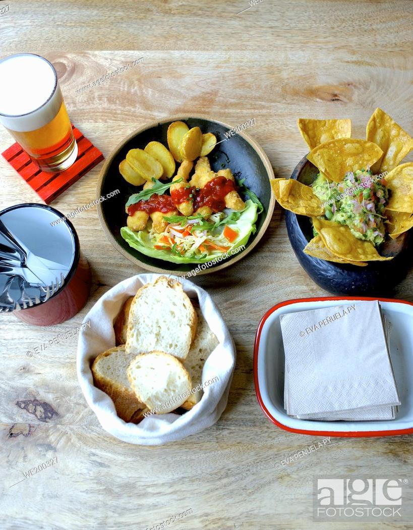 Photo de stock: Eating tapas in a restaurant.
