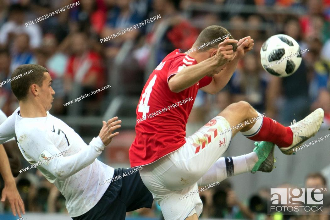 Stock Photo: 26 June 2018, Russia, Moscow, Soccer, FIFA World Cup 2018, Group C, Matchday 3 of 3 at Luzshniki Stadium: Simon Kjaer (R) from Denmark and Antoine Griezmann (L).
