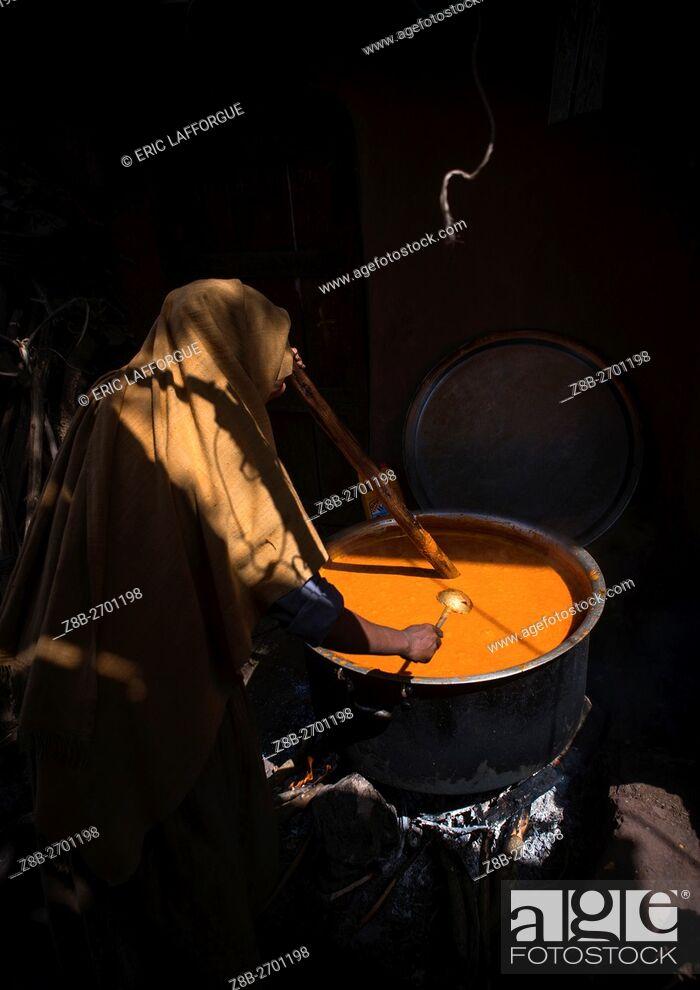Stock Photo: Ethiopia, Amhara Region, Lalibela, woman cooking churro during kidane mehret orthodox celebration.